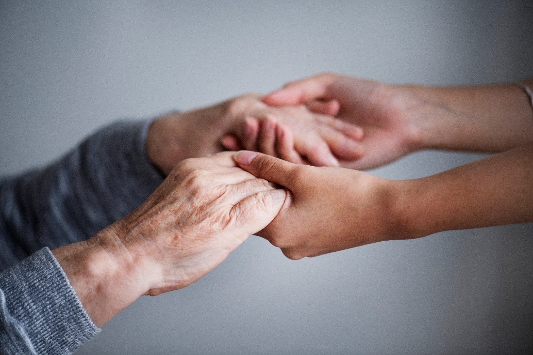 Hands support palliative care at home